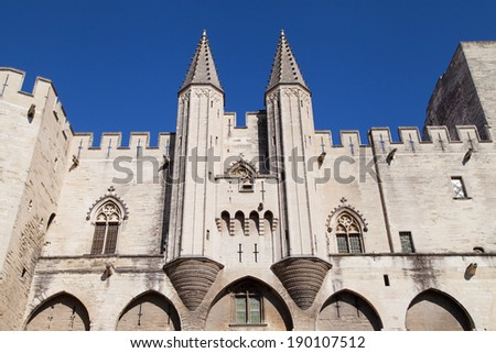 Main facade of the Palais Neuf of the Papal Palace in Avignon, France. - stock photo