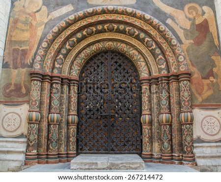 Main gate entrance into the Cathedral of the Assumption in the Kremlin. Highly decorated arches circled by paintings. - stock photo