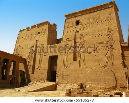 Main gate of the amazing Temple of Isis at Philae island, in Lake Nasser, with bas-reliefs of Isis, Horus and the pharaoh. Located at 11 km of Aswan, Egypt - stock photo