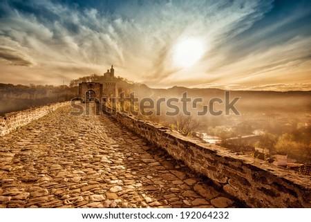 Main gate of Tzarevetz fortress in Bulgaria at sunrise - stock photo