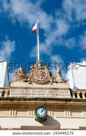 Main Guard building on St George's square,Valletta, Malta with portico on the front crowned sculpture British Royal Coat of Arms with lion and unicorn and inscription in Latin languages.  - stock photo