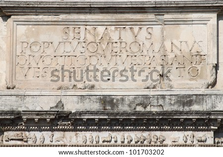 Main inscription in the Arch of Titus. Rome, Italy - stock photo
