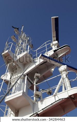 Main mast of cargo ship with navigation equipment - stock photo
