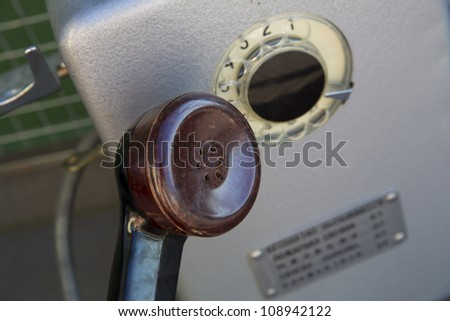 Main part of old and unused metal telephone - stock photo