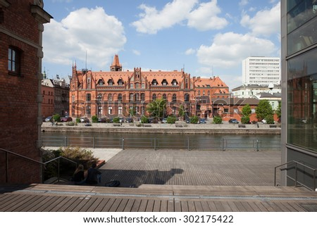 Main Post Office building in Bydgoszcz, Poland, built at the end of the 19th century and River Brda boardwalk. - stock photo