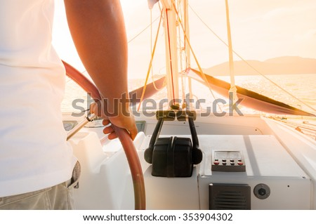Main sailing luxury yacht during golden sunset in Phuket, Thailand - stock photo