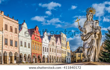 Main square of Telc with its famous 16th-century colorful houses, a UNESCO World Heritage Site since 1992, on a sunny day with blue sky and clouds, Telc, Czech Republic - stock photo