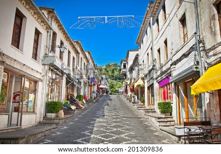 Main street  of historic town Gjirokasteron  in Gjirokaster, Albania. World Heritage Site by UNESCO. - stock photo