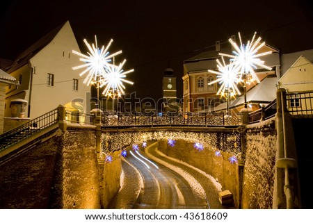 main street snow idyllic christmas in Sibiu Transylvania Romania with lights and specific decoration