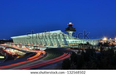 Main Terminal of Washington Dulles International Airport at dusk in Virginia, USA. - stock photo
