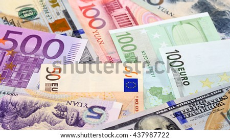 Main word currency Yuan, US Dollar and Euro bank notes concept business background