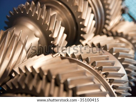 Mainshaft and Countershaft of a transmission with gears meshing. Focus on the gears. - stock photo