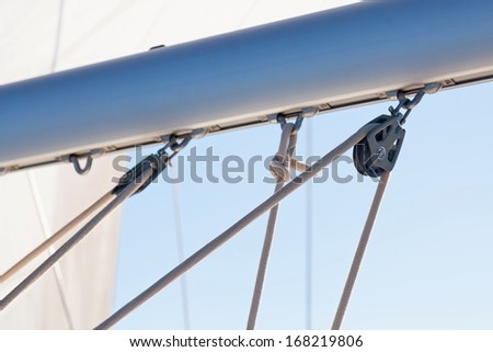 Mainsheet and roller with rope of the sailing boat  - stock photo