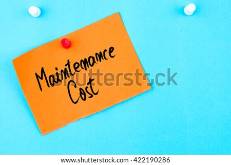 Maintenance Cost written on orange paper note pinned on cork board with white thumbtack, copy space available
