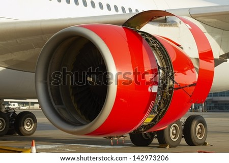 Maintenance of the jet engine before take off. - stock photo