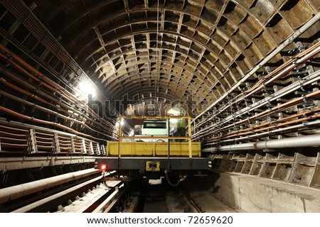 Maintenance vehicle in the tunnel of Prague subway. - stock photo
