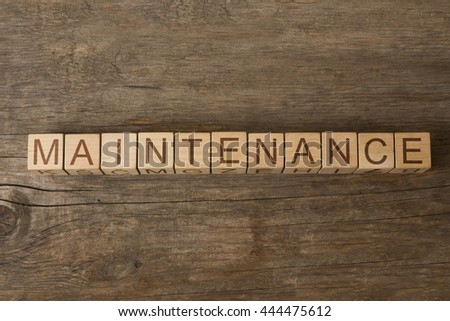 MAINTENANCE word on wooden cubes