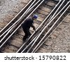 Maintenance worker fixing railway switch bolts - stock photo
