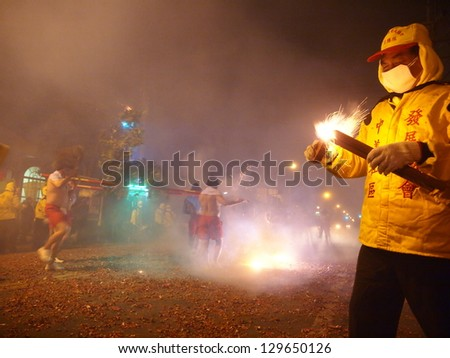 MAIOLI, TAIWAN-FEB. 22:The Bombing Lord Handan is hosted at the Lantern Festival in Maioli, Taiwan on February 22, 2013.  This custom for the Lantern Festival is also held in Taidong, Taiwan. - stock photo