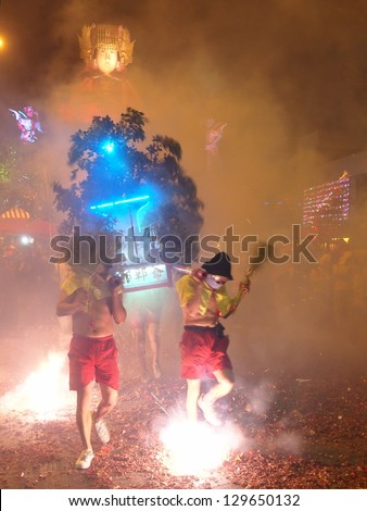 MAIOLI, TAIWAN-FEB. 22: The Bombing Lord Handan is hosted at the Lantern Festival in Maioli, Taiwan on February 22, 2013.  This custom for the Lantern Festival is also held in Taidong, Taiwan. - stock photo