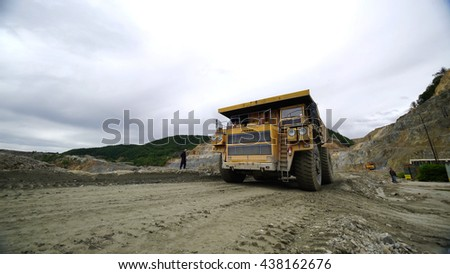 MAJDANPEK, SERBIA, MAY 2016: Super dump truck in a surface mining copper mine in Majdanpek, Serbia. Mining haul truck. Gigantic transporting vehicle. Wide angle lens shot.