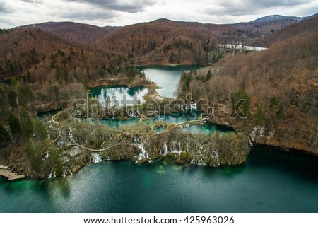 Majestic aerial view on waterfall with turquoise water in the Plitvice Lakes National Park. Croatia. Europe. - stock photo