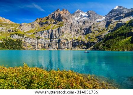 Majestic alpine lake and beautiful mountains with glaciers and green forests,Oeschinen lake,Bernese Oberland,Switzerland,Europe - stock photo