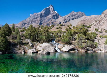 Majestic blue mountain lake in Tajikistan. Fann Mountains - stock photo