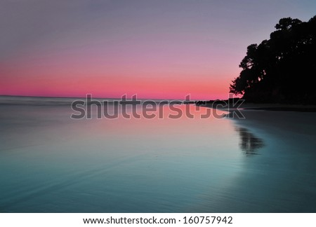 majestic colorful vista of sunset over beach at Noosa Headland, Queensland, australia - stock photo