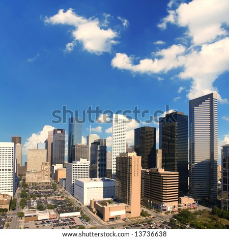 Majestic downtown Houston Texas skyline with wide open sky and clouds