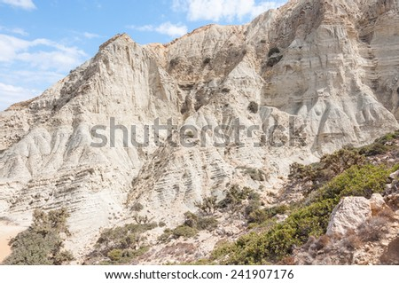 Majestic geological clay formation on the way to the Patamos beach on the west side of Gavdos. There is a canyon with steep cliffs with holes and small caves close to the beach.  - stock photo