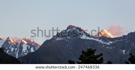 Majestic high peaks of Southern Alps at sunset, New Zealand. - stock photo