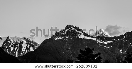 Majestic high peaks of Southern Alps in black and white at sunset, New Zealand. - stock photo