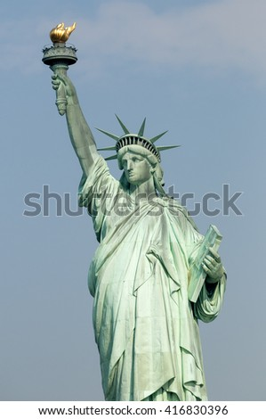 Majestic iconic lady liberty statue of liberty in New York harbor welcoming new arrivals vertical tall format orientation  - stock photo