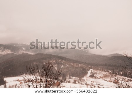 Majestic landscape glowing by sunlight in the morning. Dramatic and picturesque wintry scene. Location Carpathian, Ukraine, Europe. Ski resort. Beauty world. Instagram toning effect. Happy New Year! - stock photo