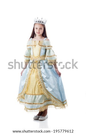 Majestic little girl posing in royal dress - stock photo