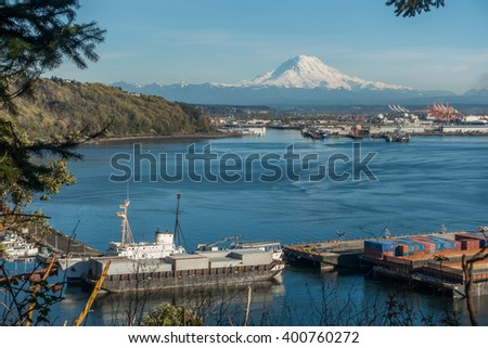 Majestic Mount Rainier towers over the Port of Tacoma. - stock photo