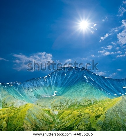 majestic mountain in a rays of sun - stock photo