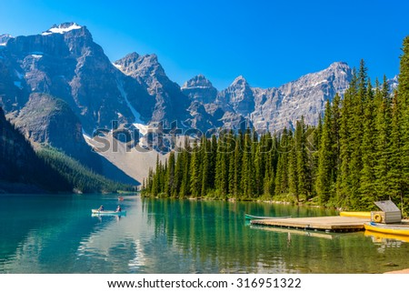 Majestic mountain lake in Canada. Moraine Lake in Alberta, Canada. - stock photo