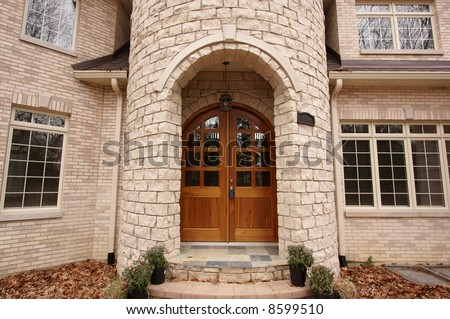 Majestic Newly Constructed Home Facade on a Blustery Day - stock photo