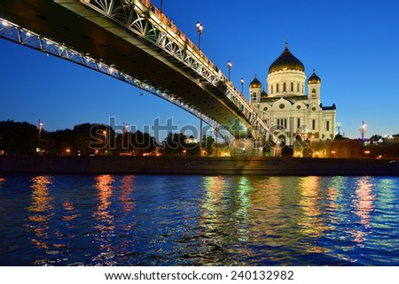 Majestic orthodox Cathedral of Christ Saviour illuminated at dusk on bank of Moscow river, Moscow, Russia. It is tallest Orthodox church in world - stock photo