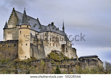 Majestic Picture of Vianden Castle in Luxembourg on a Cloudy Day. - stock photo