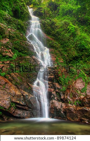 Majestic Rimbi waterfall in Kanchenjunga National Park in Sikkim - stock photo