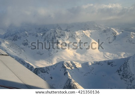 majestic snowy mountain in northern norway aerial overview