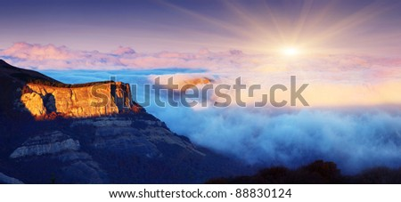 Majestic sunset in the foggy mountains landscape.