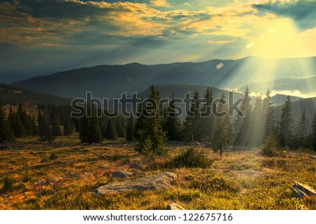 Majestic sunset in the mountains landscape.Sunset landscape in Carpathian mountains.Dawn in mountains Carpathians, Romania