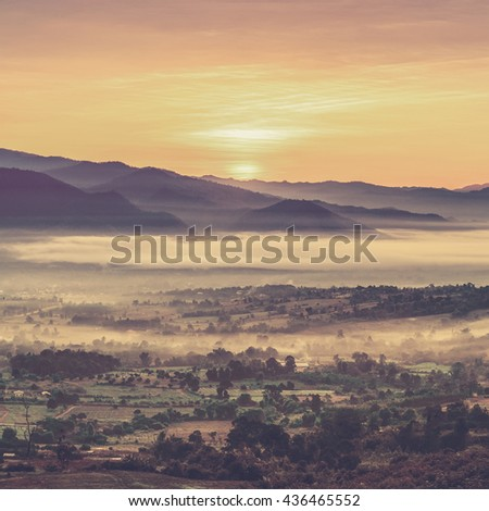 Majestic sunset in the mountains landscape (Vintage filter effect used) - stock photo