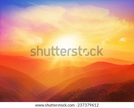 Majestic sunset in the mountains landscape with sunny beams. Dramatic scene. Carpathian, Ukraine, Europe. Colorful sky. - stock photo