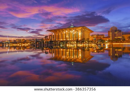 Majestic view of Sultan Mizan Zainal Abidin Mosque (Iron Mosque) Putrajaya during blue hour sunrise with full reflection. Soft focus due to long exposure shot at dawn. - stock photo