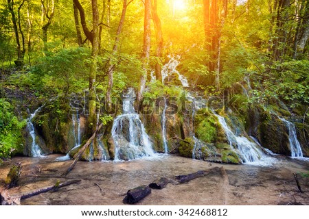 Majestic view on turquoise water and sunny beams in the famous resort Plitvice Lakes National Park. Croatia. Europe. Dramatic scene. Beauty world. Retro and vintage style. Instagram toning effect. - stock photo